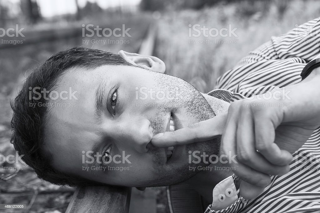 model lying on the rail stock photo
