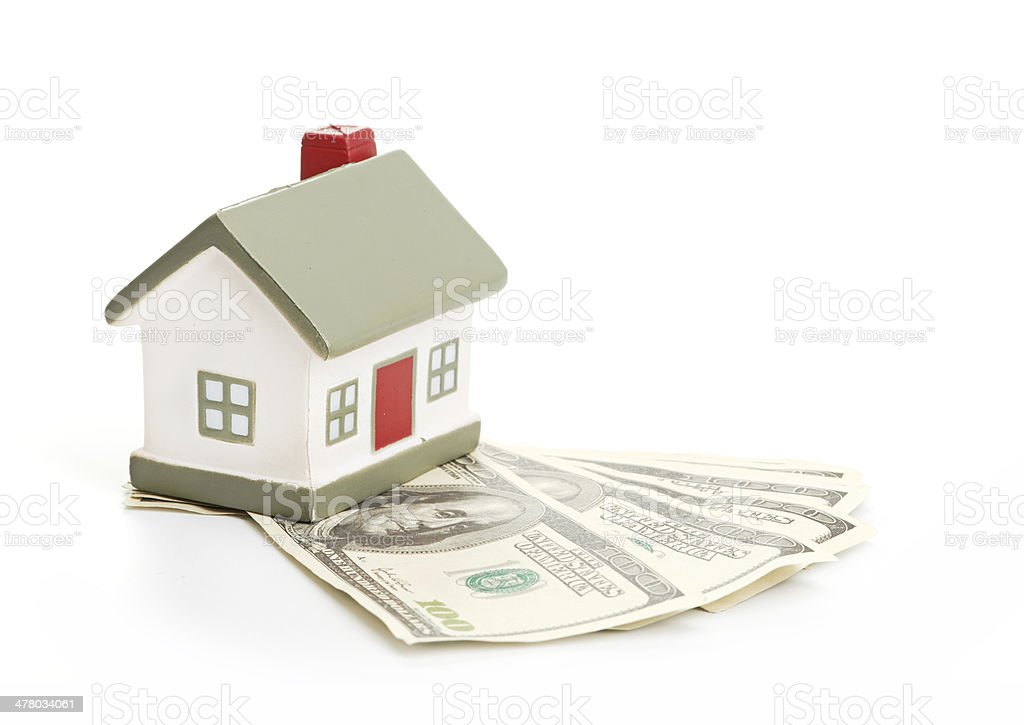 Model of a house lying on some banknotes royalty-free stock photo