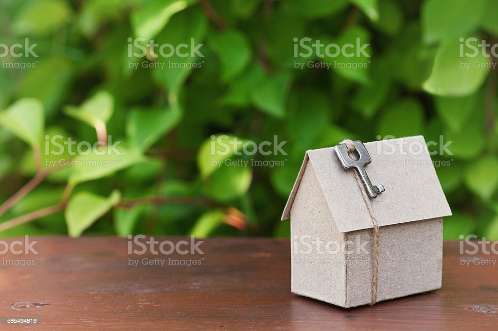 Model of cardboard house. Purchase, rent, construction, real estate concept stock photo