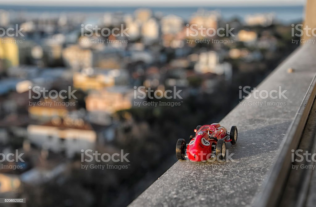 Model of famous classic car from the window of skyscraper stock photo