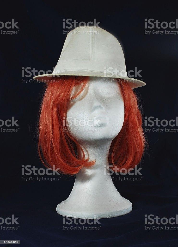 Model of polystyrene pink wig white hat royalty-free stock photo