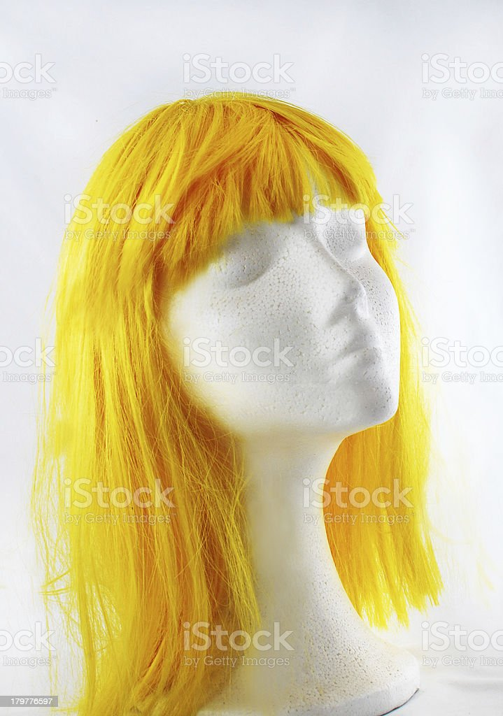 Model of polystyrene yellow wig royalty-free stock photo