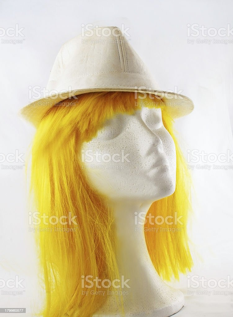 Model of polystyrene yellow wig white hat royalty-free stock photo