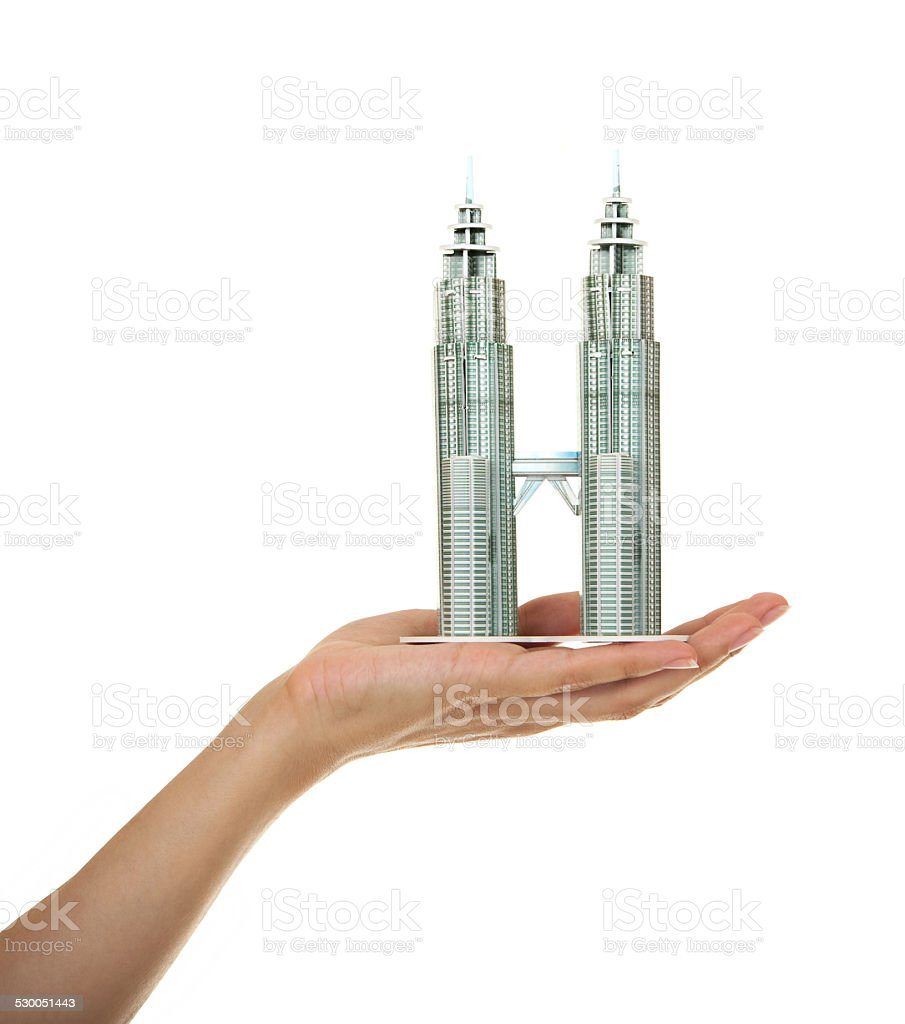 Model of skyscrapers 'Petronas Twin Towers' in the female hand. stock photo