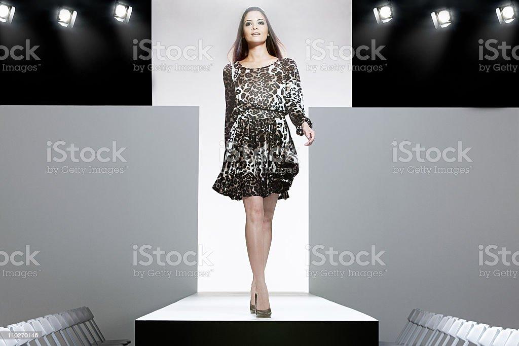 Model on catwalk at fashion show stock photo