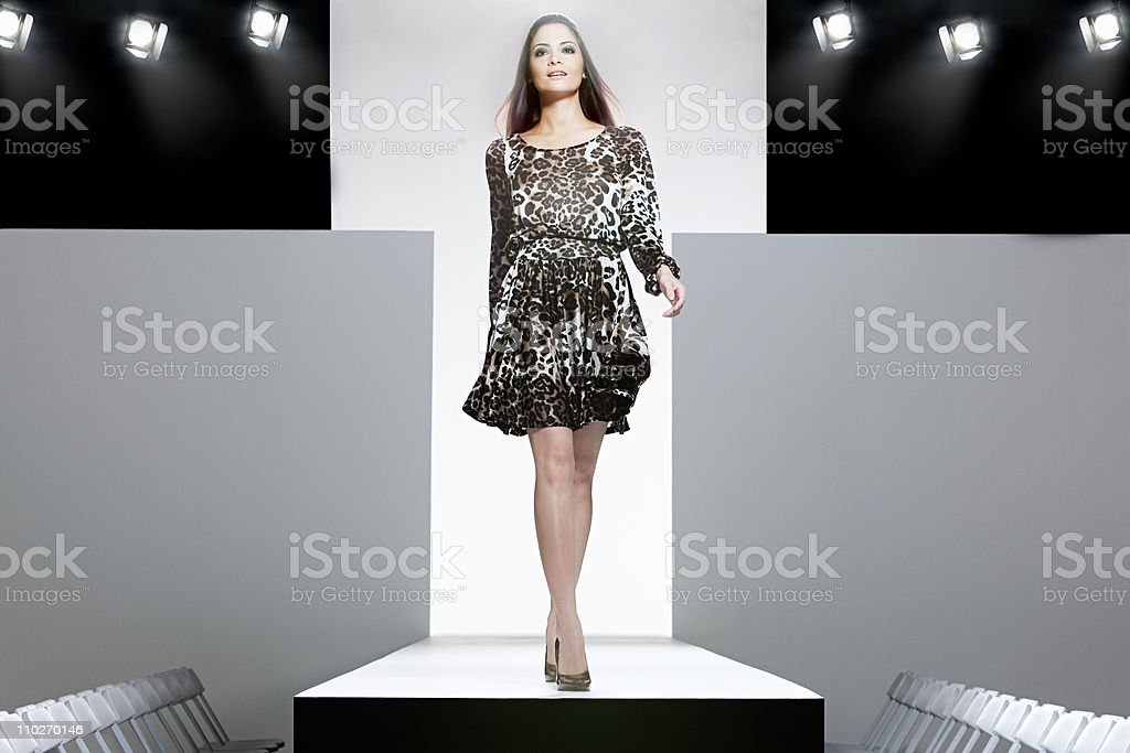 Model on catwalk at fashion show stock photo