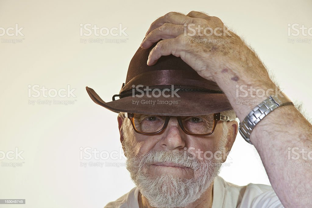 Model Placing Hat On Head royalty-free stock photo