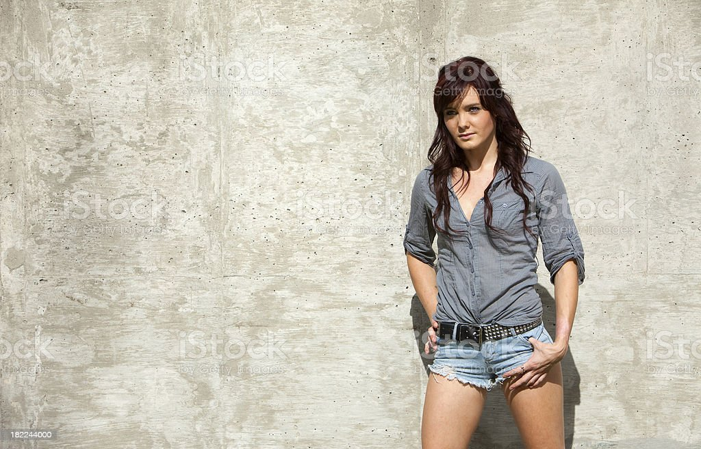Model posing next to wall royalty-free stock photo