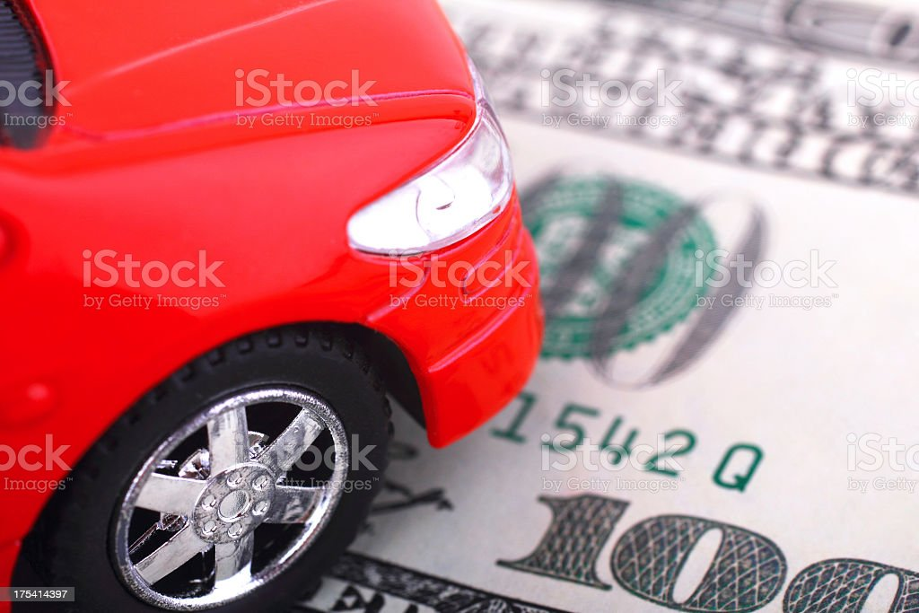 Model Red car on 100 dollar bill stock photo