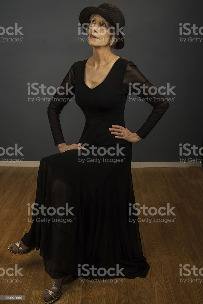 Model Seated With Hands On Hips royalty-free stock photo