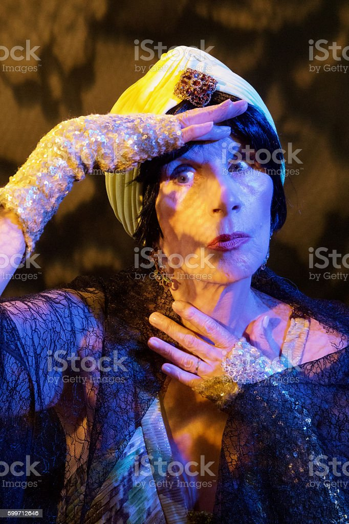 Model Shielding Her  Eyes From The Lights stock photo