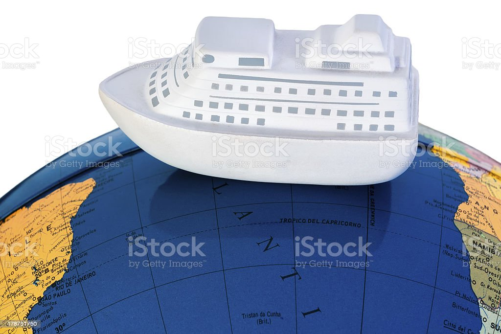 Model Ship on a World Map. White Background royalty-free stock photo