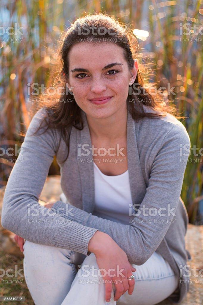 Model sitting smiling stock photo