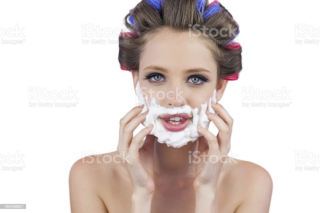 Model touching her face with shaving foam stock photo