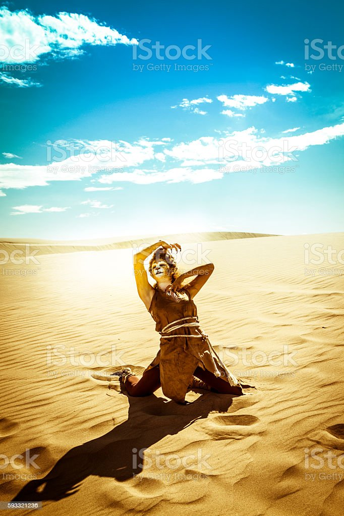 Model Wearing Cheetah Makeup Posing The Desert stock photo
