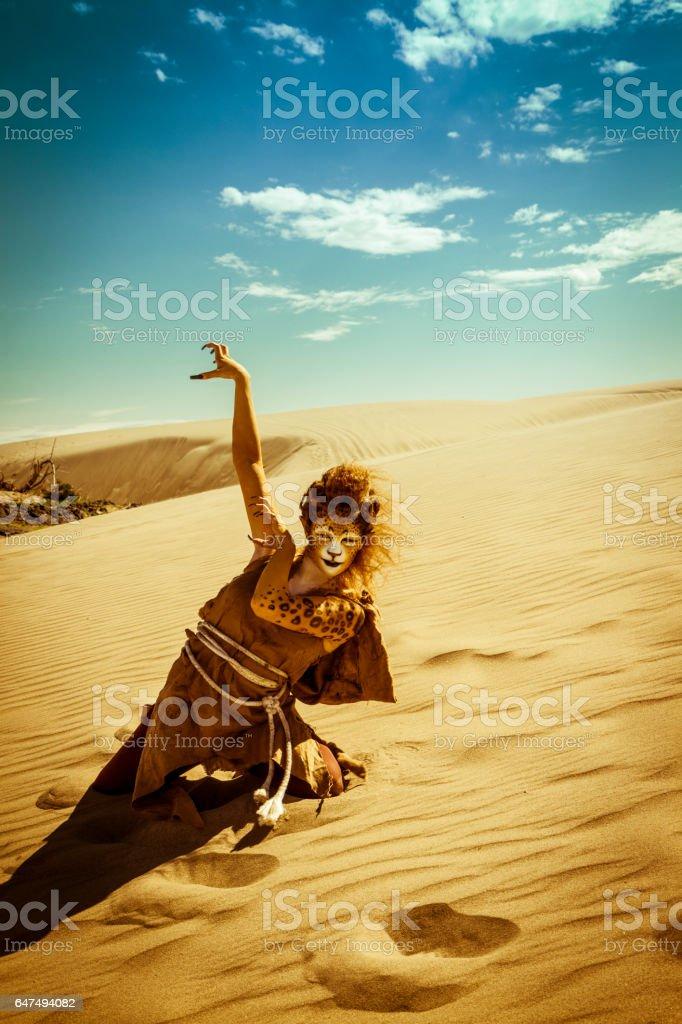 Model Wearing Cheetah Makeup Posing The Desert stock photo