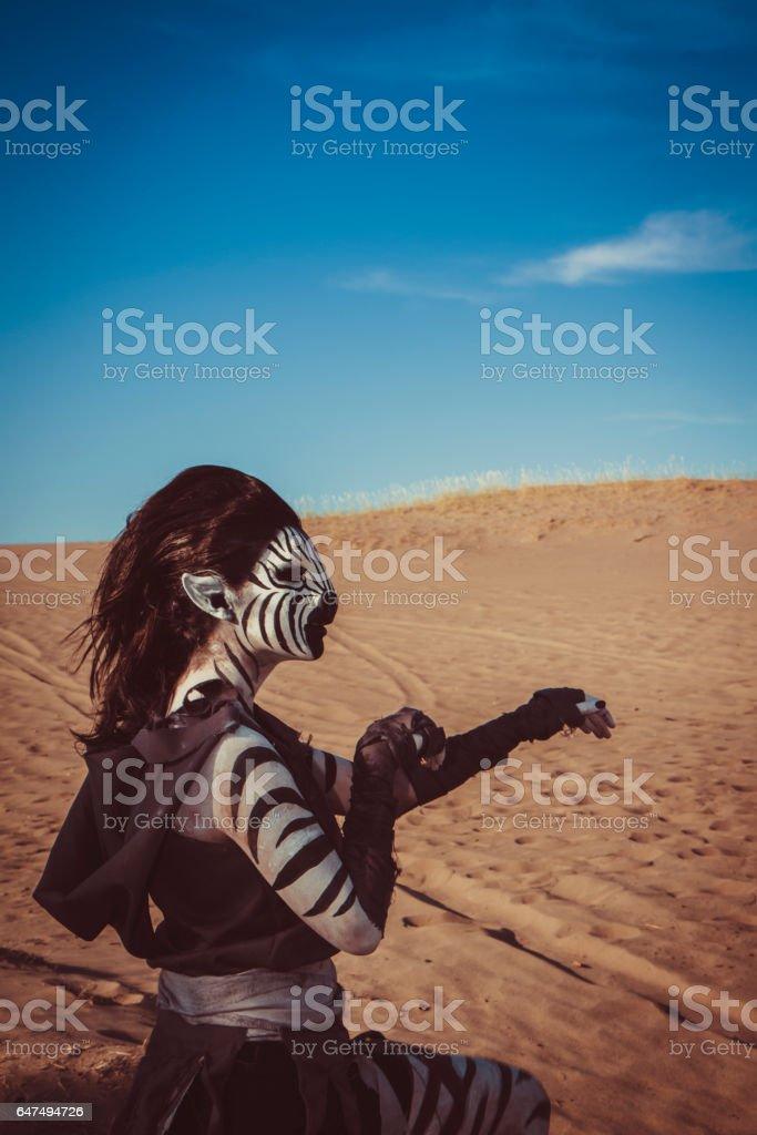 Model Wearing Zebra Makeup Posing The Desert stock photo