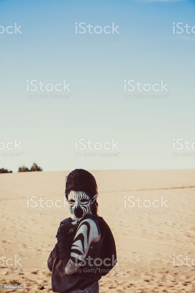 Model Wearing Zebra Makeup Posing The Desert stock photo
