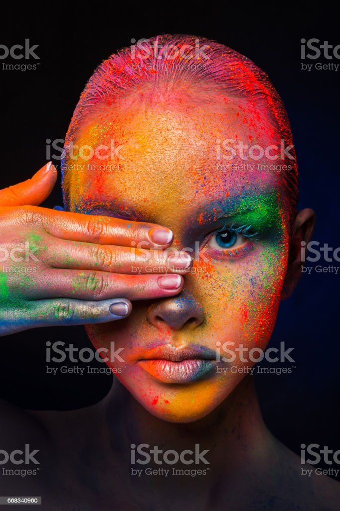 Model with colorful art make-up, close-up stock photo