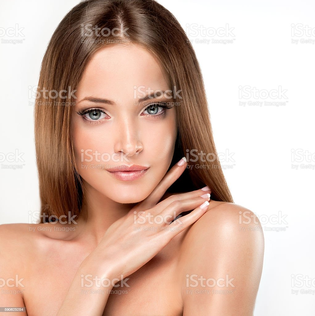 Model with delicate make-up and long shiny hair. stock photo