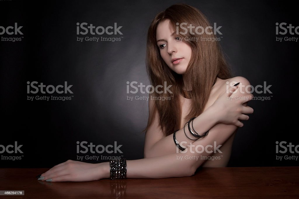 model with long curly ginger hair and natural make-up stock photo
