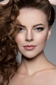 Model with long hair. Waves Curls Hairstyle. Hair Salon. Updo