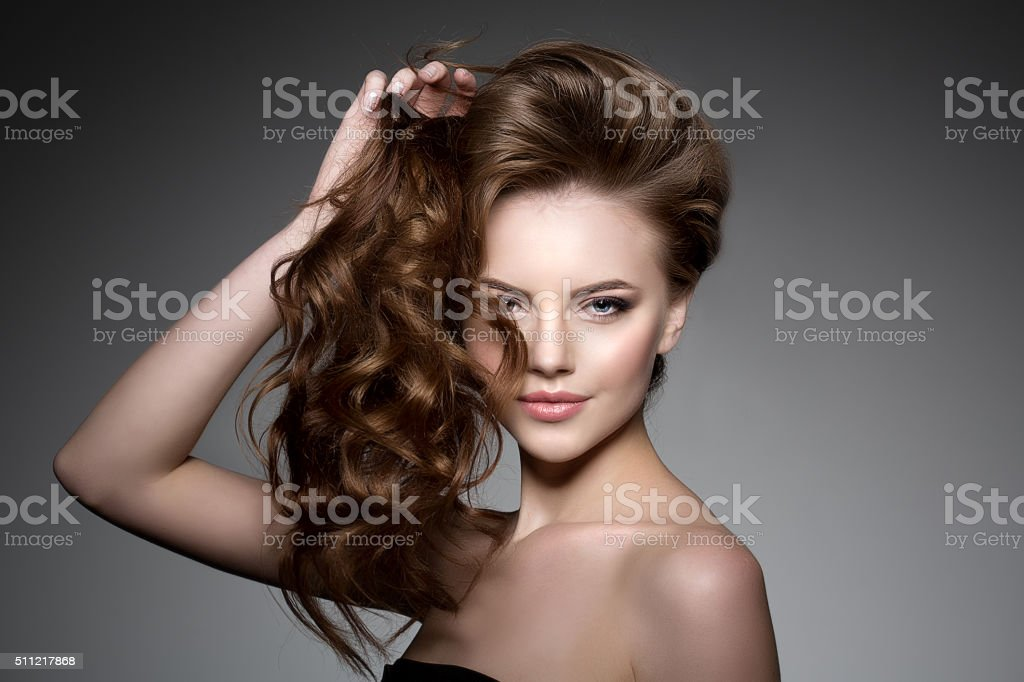 Model with long hair. Waves Curls Hairstyle. Hair Salon. Updo stock photo