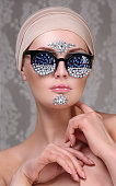 Model with makeup and jewelry, rhinestones