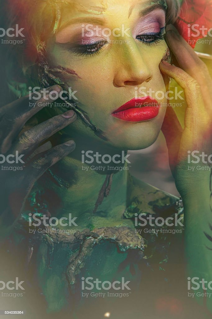 Model woman in the form of a nymph among stock photo
