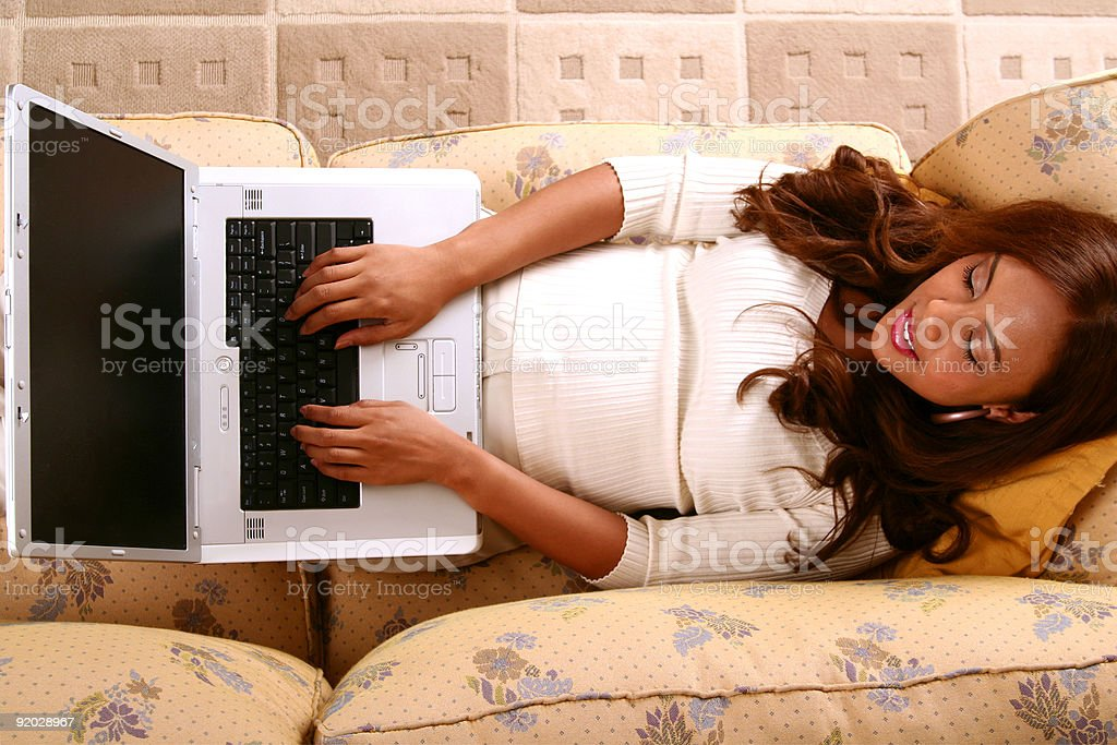 Model Working With Laptop In Her Home royalty-free stock photo