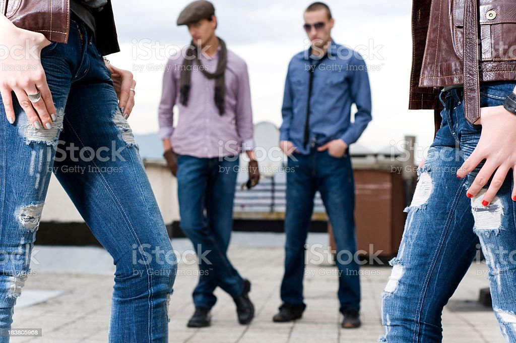 Models in different styles of blue jeans stock photo