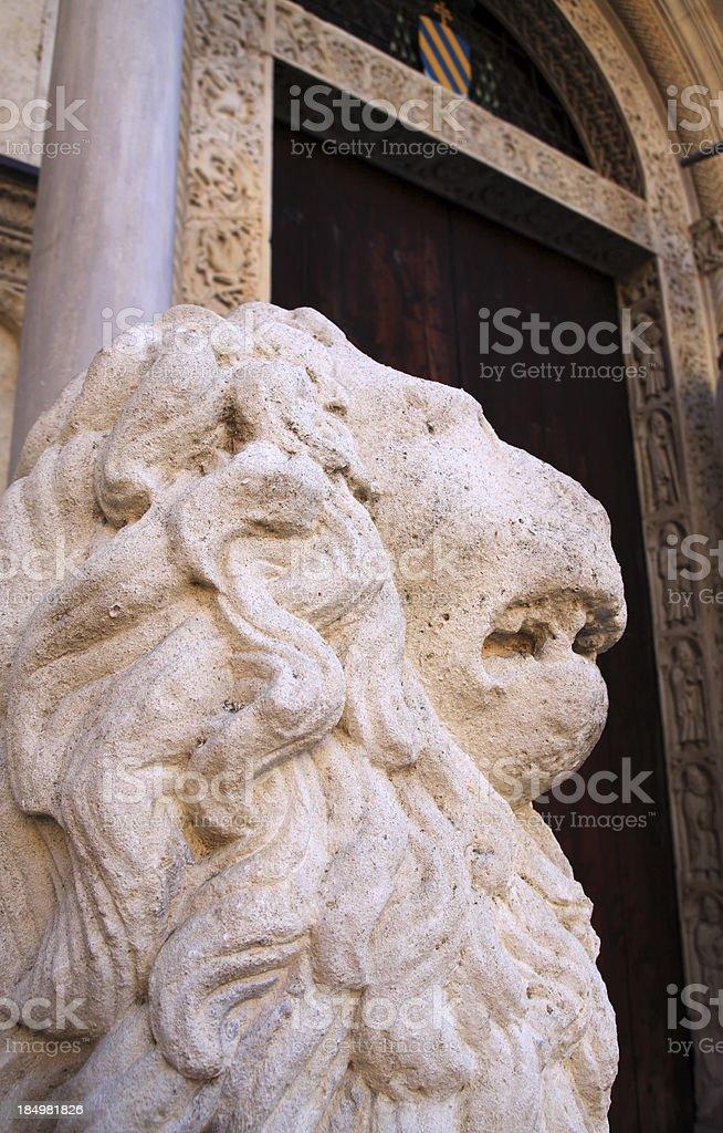 Modena, Cathedral: lion statue and reliefs on the main gate royalty-free stock photo