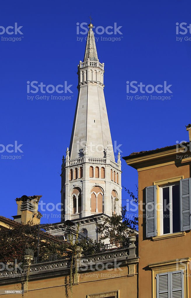 Modena, Cathedral: the Ghirlandina bell-tower emerging from behind houses royalty-free stock photo