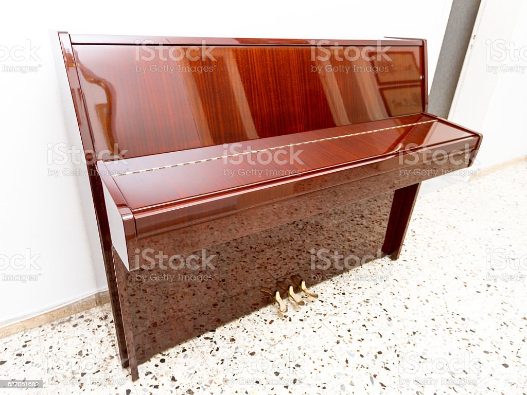Modern acoustic compact piano in a house stock photo