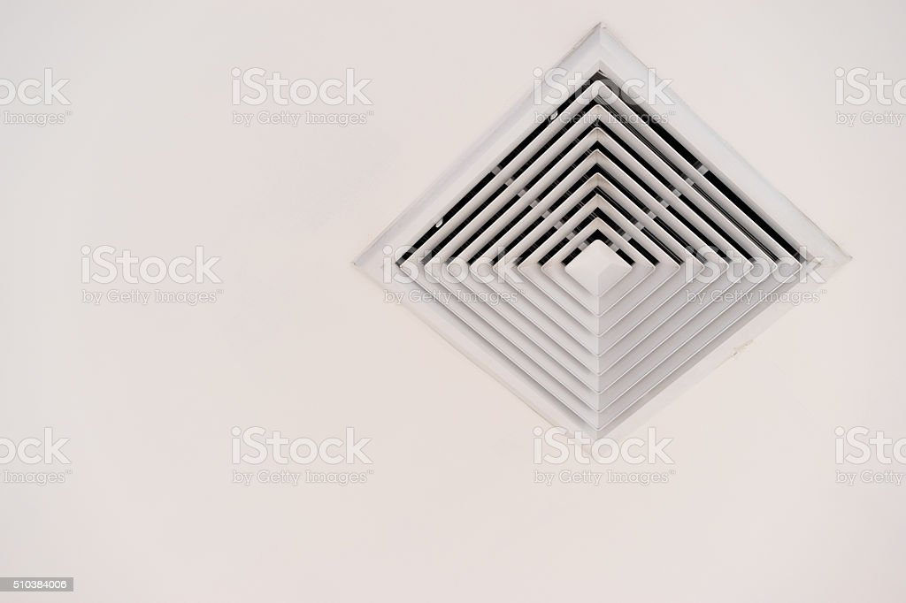 Modern air conditioner or vent on ceiling with clipping path stock photo