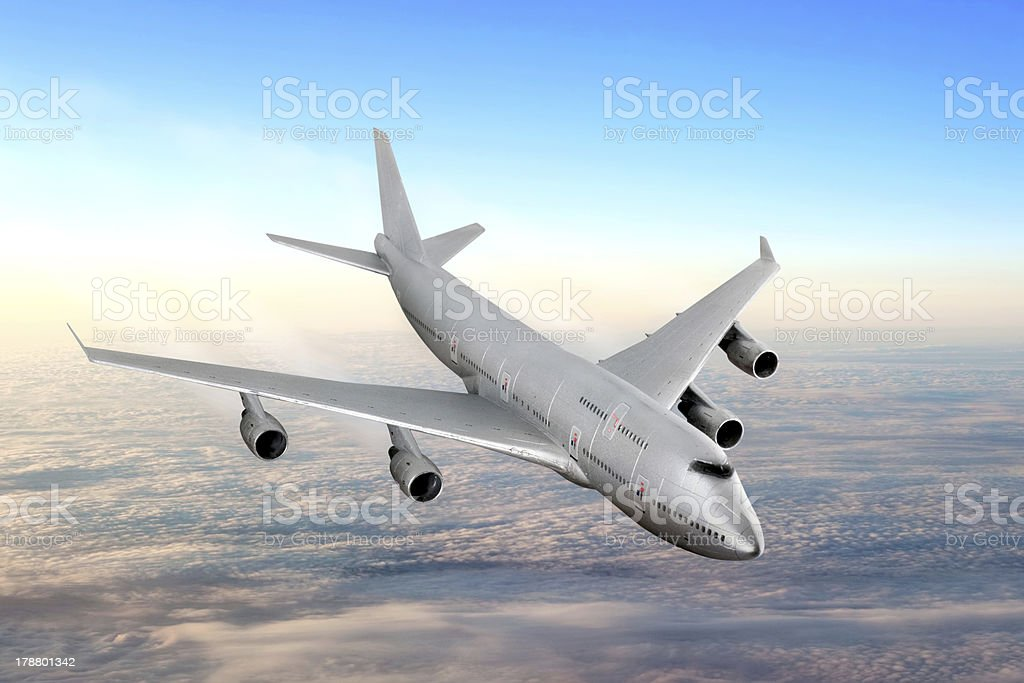 Modern airplane  in the sky near Airport. stock photo