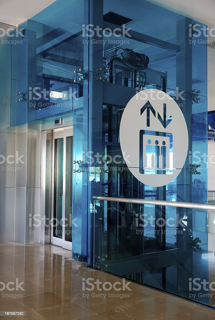 Modern airport elevator in blue and white royalty-free stock photo