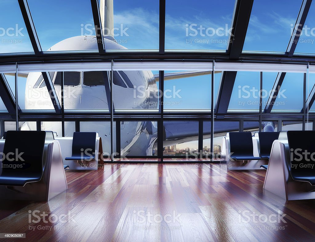 Modern airport passenger terminal with city background stock photo