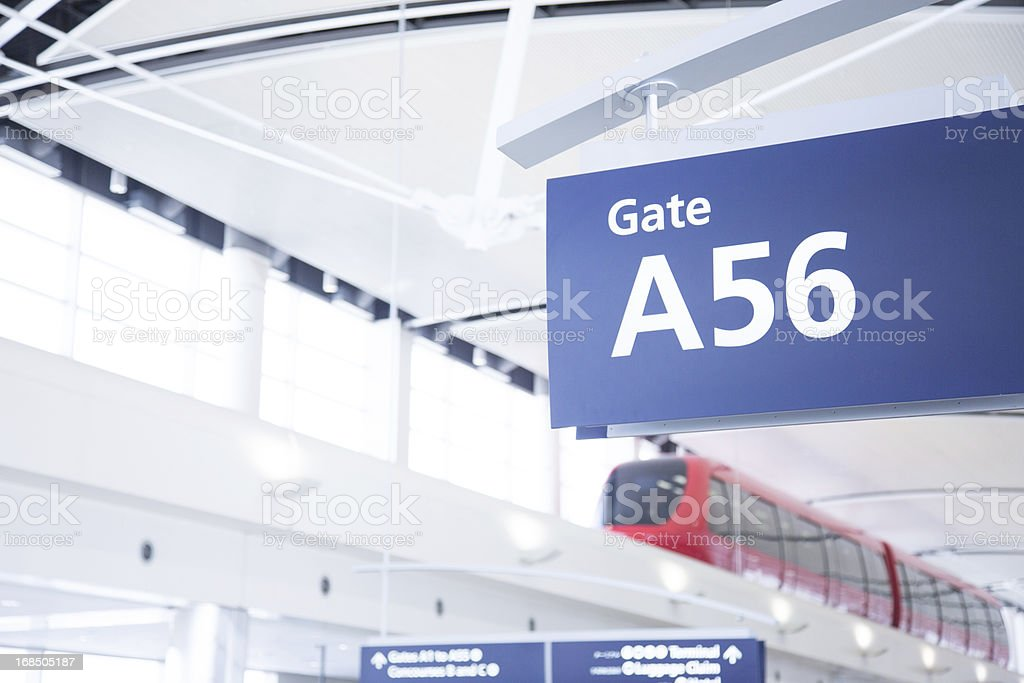 Modern Airport Tram and Gate Sign royalty-free stock photo