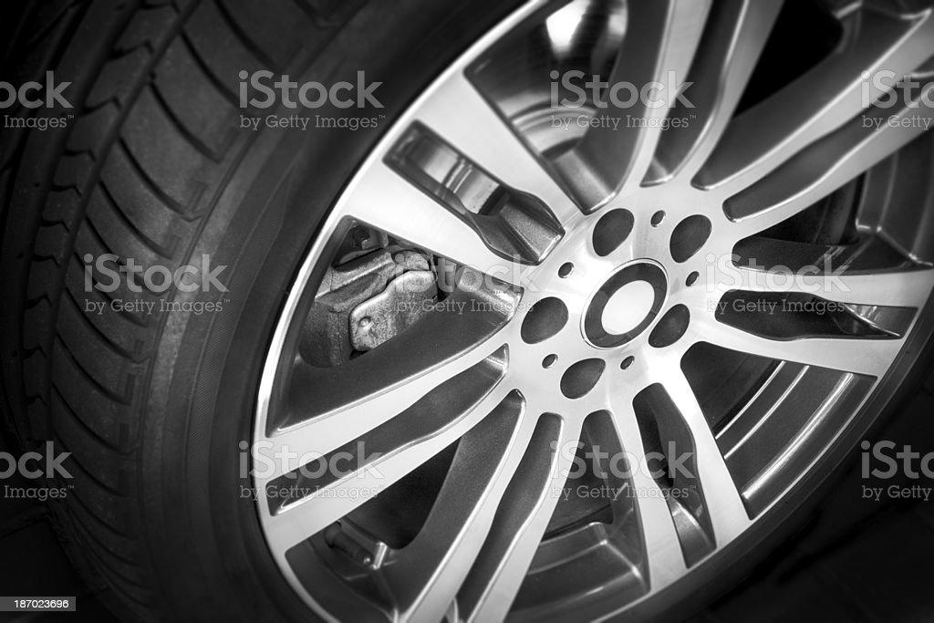 Modern alloy wheel with seven spokes on black stock photo