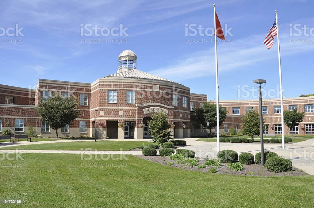 modern American high school exterior stock photo