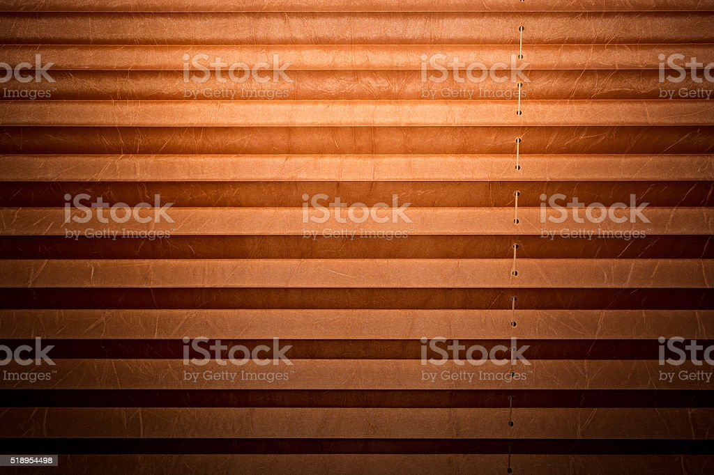Modern and brown pleated blinds, texture with shadows stock photo