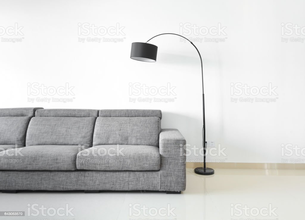 Modern and clean decoration of an apartment with a sofa and a lamp stock photo