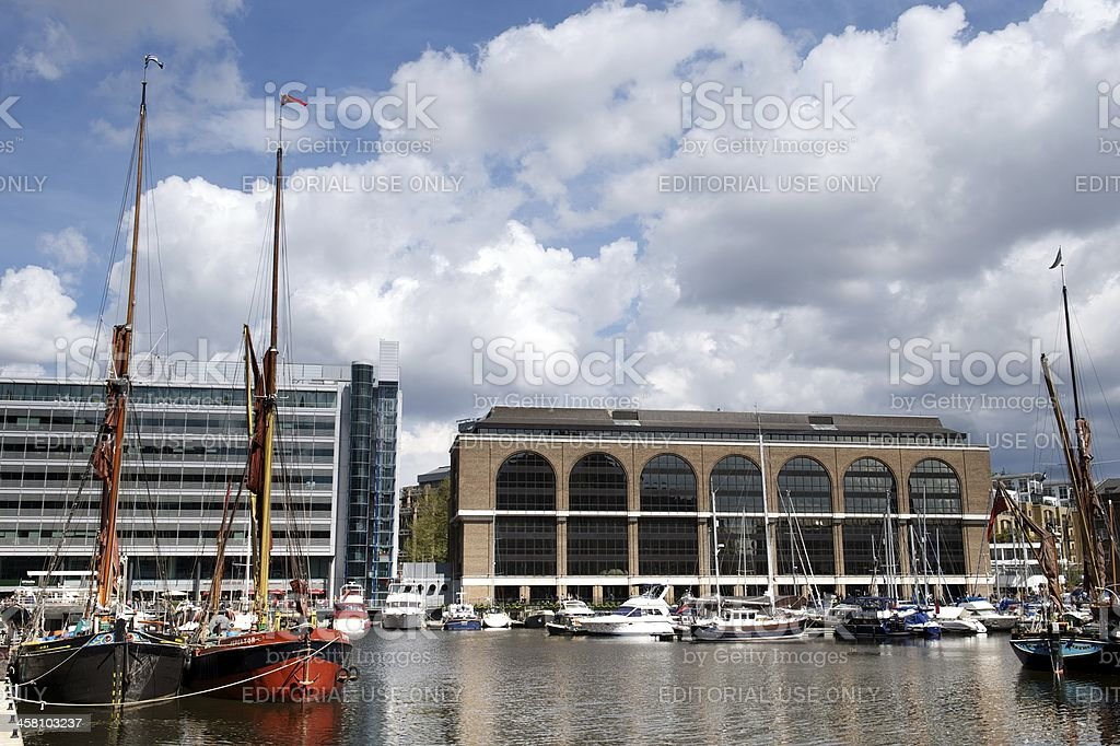 Modern and historic boats, buildings, St Katherine Docks, London, UK royalty-free stock photo