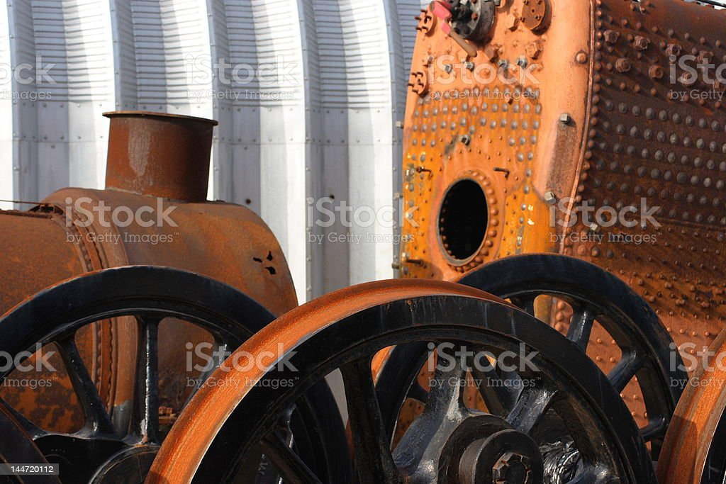 Modern and old - rusting metal steam train parts royalty-free stock photo