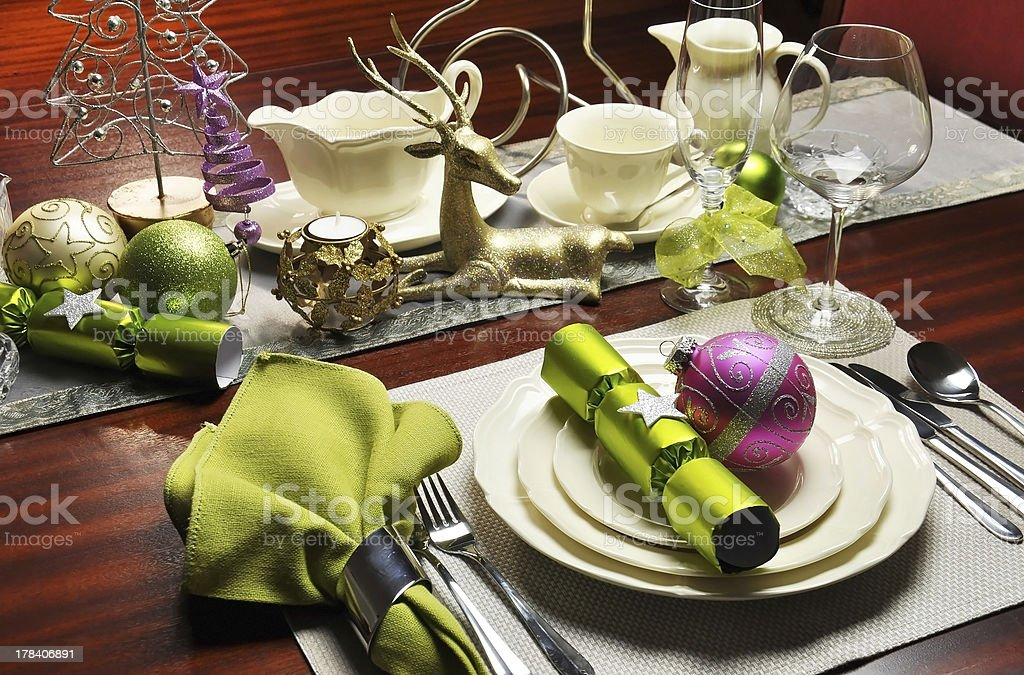 Modern and stylish Christmas Eve dinner table setting royalty-free stock photo