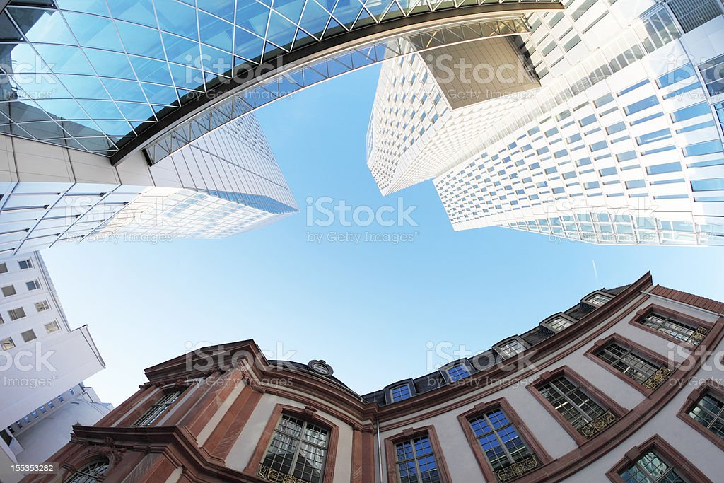 modern and traditional german buildings against blue sky in Frankfurt royalty-free stock photo
