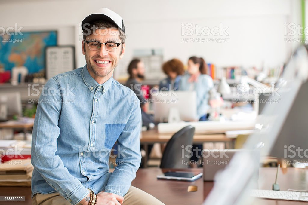 Modern and trendy man working on startup stock photo