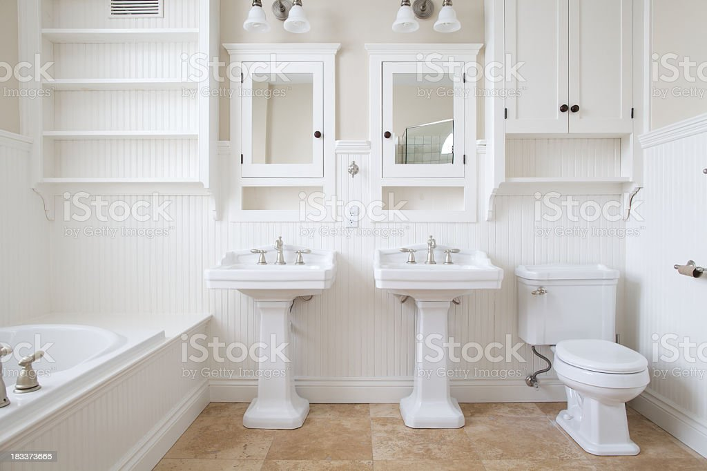 Modern and white washroom with bathtub and two mirrors stock photo