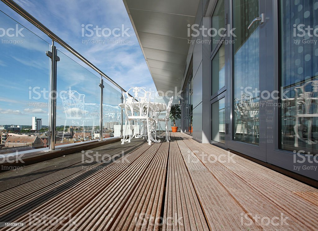 Modern Apartment Balcony with Wooden Decking stock photo